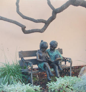 sculpture of students reading